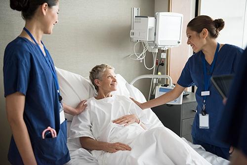 Nurse Patient In Patient's Room.jpg
